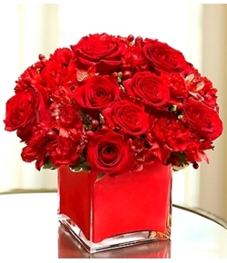 one dozen roses in a vase to japan